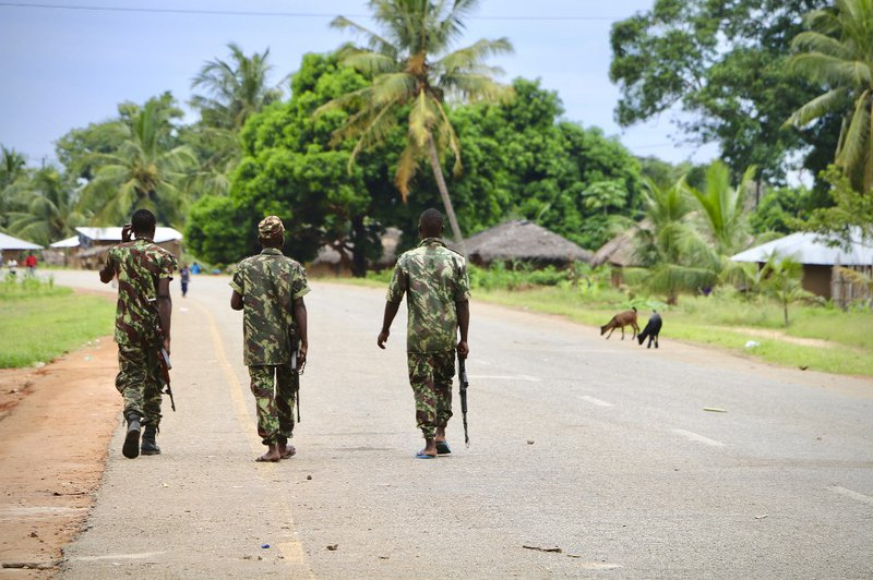 Soldiers from the Mozambican army patrol the streets after security in the area was increased, following a two-day attack from suspected islamists in October last year, on March 7, 2018 in Mocimboa da Praia, Mozambique.