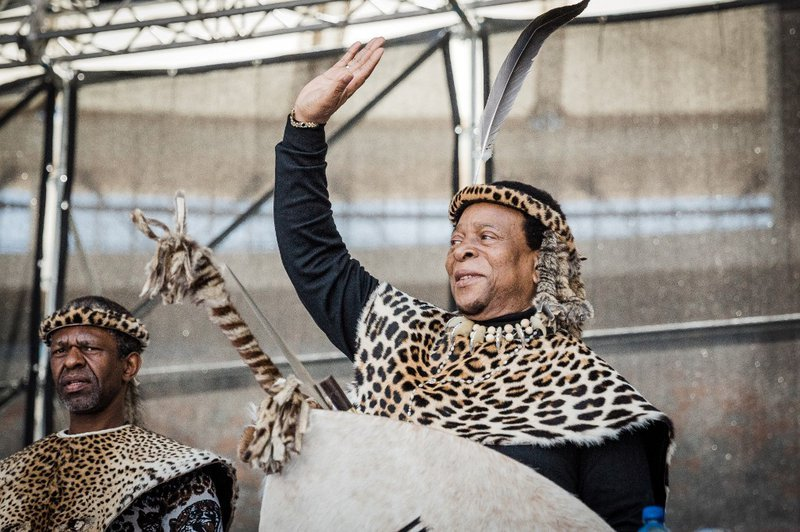 Zulu King Goodwill Zwelithini greets his supporters at The Moses Mabhida Football Stadium in Durban