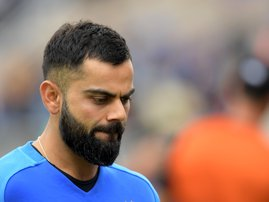 ndia's captain Virat Kohli reacts at the end of play during the 2019 Cricket World Cup first semi-final between New Zealand and India at Old Trafford in Manchester, northwest England, on July 10, 2019. New Zealand beat India by 18 runs. Dibyangshu Sarkar
