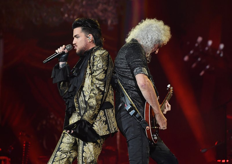 Adam Lambert and Brian May of Queen perform onstage at the 2019 Global Citizen Festival / AFP