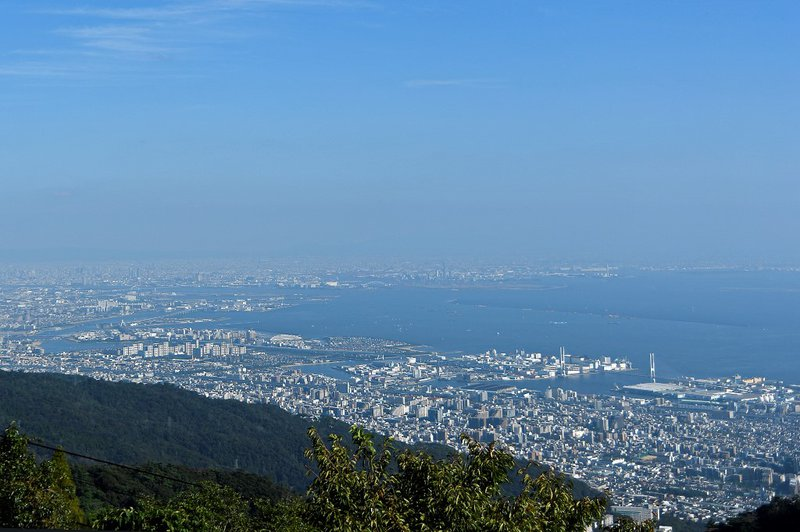 The skyline and port of the city of Kobe is pictured from a lookout point on top of Rokkosan mountain on October 5, 2019.