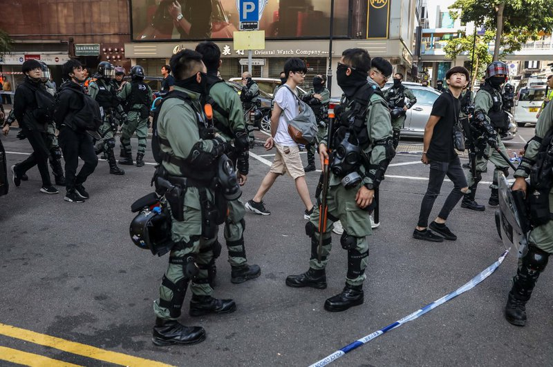 People are detained by police near the Hong Kong Polytechnic University in Hung Hom district of Hong Kong
