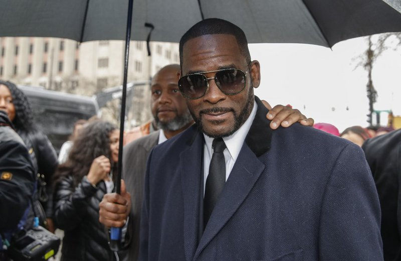 In this file photo taken on May 7, 2019 R. Kelly leaves the Leighton Criminal Court Building after a hearing on sexual abuse charges in Chicago, Illinois. R&B singer R. Kelly pleaded not guilty on December 18, 2019 to bribery charges that US media say rel