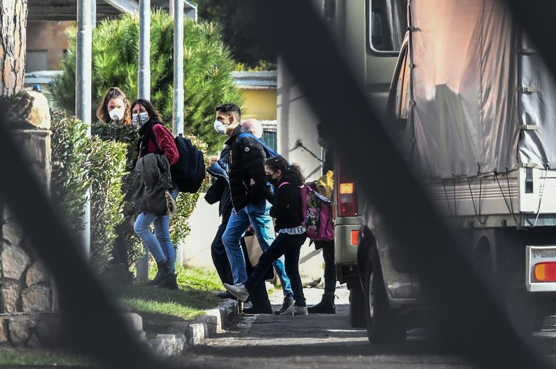 Italian citizens arrive at the Cecchignola quarantine center, south of Rome, on February 3, 2020 after being repatriated from the coronavirus hot-zone of Wuhan and landing at the nearby military airport of Pratica di Mare.