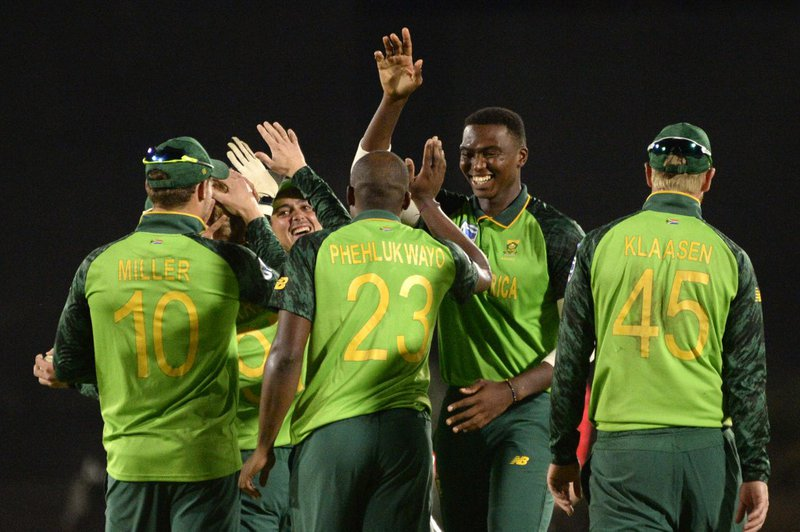 South African team members celebrate the dismissal of Australia's Pat Cummins (not seen) during their first One Day International cricket match in the three match series against Australia at Boland Park Cricket Stadium on February 29, 2020 in Paarl.