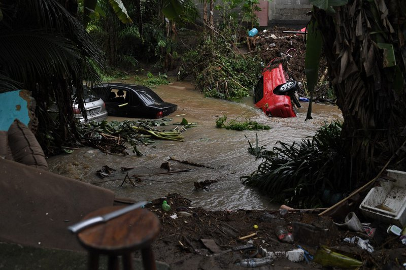 Cars swept by a flood caused heavy rains during the weekend are seen in Realengo neighbourhood, in the suburbs of Rio de Janeiro, Brazil, on March 2, 2020.