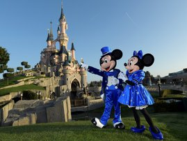 In this file photo Disney characters Mickey and Mini mouse pose on March 16, 2017 in front of the Sleeping Beauty Castle to mark the 25th anniversary of Disneyland - originally Euro Disney Resort - in Marne-La-Vallee, east of the French capital Paris. Dis