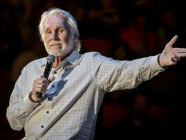 his file photo taken on March 19, 2017 shows US singer Kenny Rogers performing in concert on his 'Farewell Tour' during Rodeo Austin at the Travis County Expo Center in Austin, Texas. Country music legend Kenny Rogers, whose career spanned six decades, ha