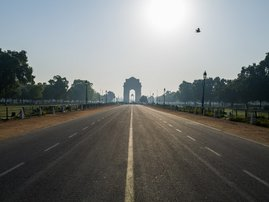 A deserted Rajpath road leading to India Gate is seen during a one-day Janata (civil) curfew imposed as a preventive measure against the COVID-19 coronavirus in New Delhi on March 22, 2020. Nearly one billion people around the world were confined to their
