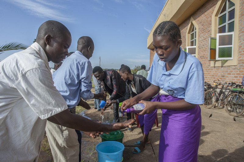 Parishoners wash hands as a preventive measure against the spred of the COVID-19 coronavirus on the last day of full gatherings as a parish at the Saint Don Bosco Catholic Parish in Lilongwe on March 22, 2020. Malawian President Arthur Peter Mutharika, wh