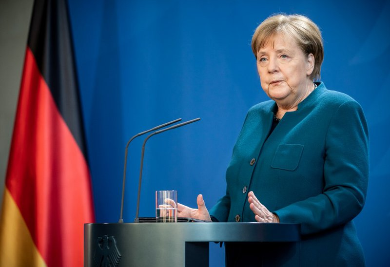 German Chancellor Angela Merkel makes a press statement on the spread of the new coronavirus COVID-19 at the Chancellery, in Berlin on March 22, 2020. German Chancellor Angela Merkel is going in to quarantine after meeting virus-infected doctor according
