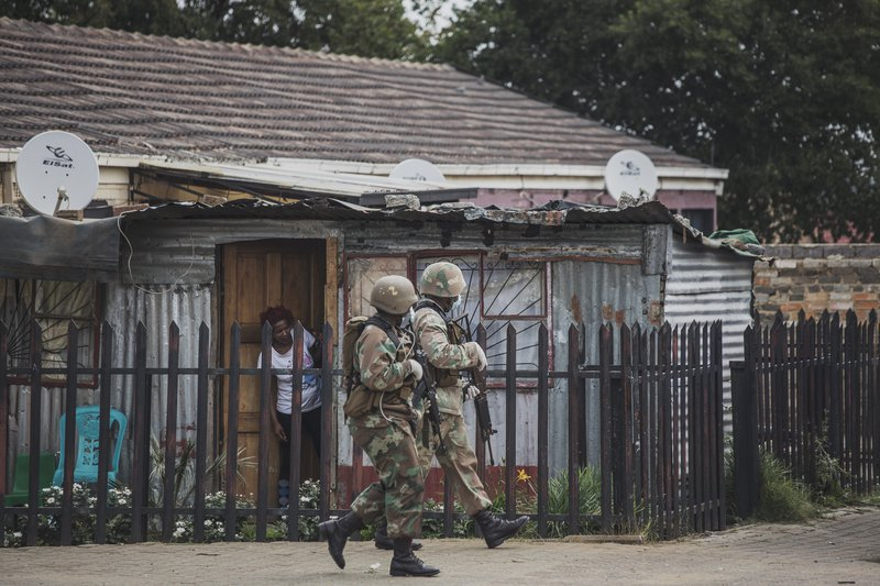 A South African National Defence Force (SANDF) patrol is seen in Eldorado Park on March 30, 2020. South Africa came under a nationwide lockdown on March 27, 2020, joining other African countries imposing strict curfews and shutdowns in an attempt to halt