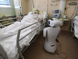 One of the six robots of the Circolo di Varese hospital stands near a patient, on April 3, 2020, to help the healthcare staff of the High Intensity Medicine department to assist twelve patients suffuring from the epedemic Covid-19, caused by the novel cor