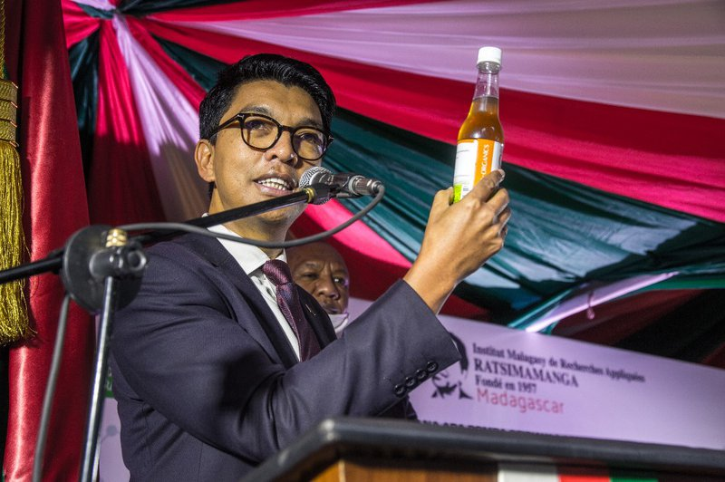 "The President of Madagascar Andry Rajoelina attends a ceremony to launch ""Covid Organics"" or CVO, in Antananarivo, on 20 April 2020, a remedy from the Malagasy Institute of Applied Research (IMRA) created from the Artemisia plant and supposed to prevent a"
