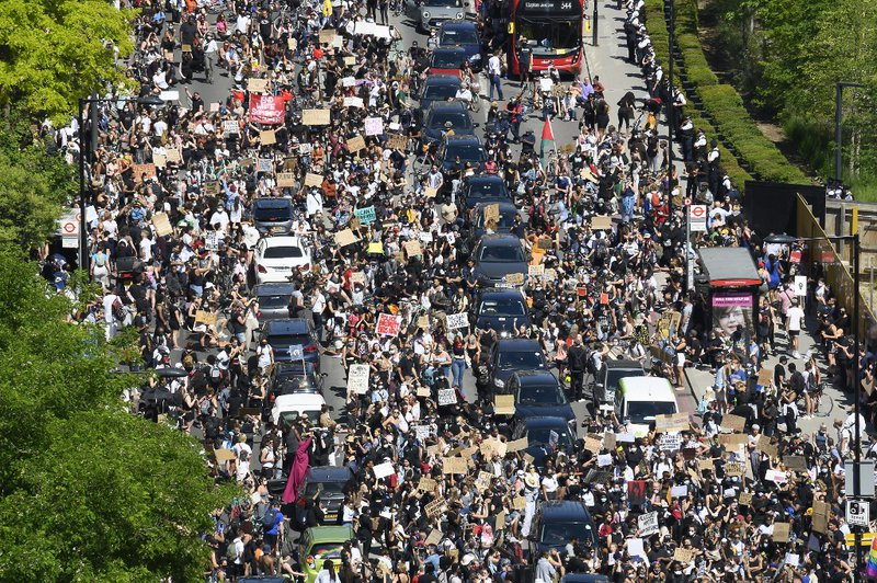 Demonstrators block the road as they gather outside the US Embassy in London on May 31, 2020 to protest the death of George Floyd, an unarmed black man who died after a police officer knelt on his neck for nearly nine minutes during an arrest in Minneapol