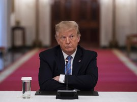 US President Donald Trump sits with his arms crossed during a roundtable discussion on the Safe Reopening of America's Schools during the coronavirus pandemic, in the East Room of the White House on July 7, 2020, in Washington, DC.