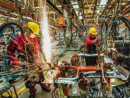 This file photo taken on June 30, 2020 shows employees working at a welding workshop in a car factory in Weifang in China's eastern Shandong province. China's factory-gate prices fell less than expected in June, official data showed on July 9, 2020, as t