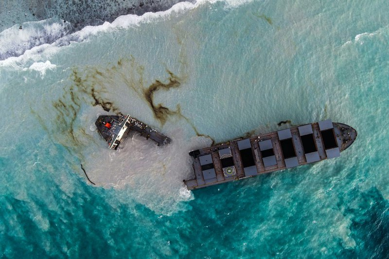 This aerial picture taken on August 16, 2020, shows the MV Wakashio bulk carrier that had run aground and broke into two parts near Blue Bay Marine Park, Mauritius. A ship that has leaked more than 1,000 tonnes of oil in pristine waters off the Mauritius