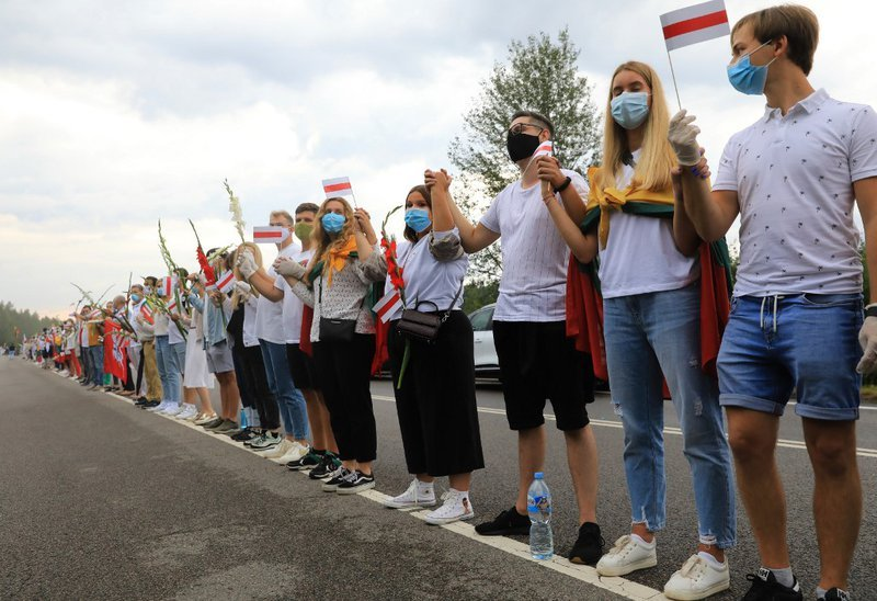 People form a human chain from Vilnius to Medininkai along the border with Belarus to show solidarity with the Belarussian people in Medininkai, Lithuania on August 23, 2020. Three decades after their gesture of defiance against the Soviet Union, Baltic r