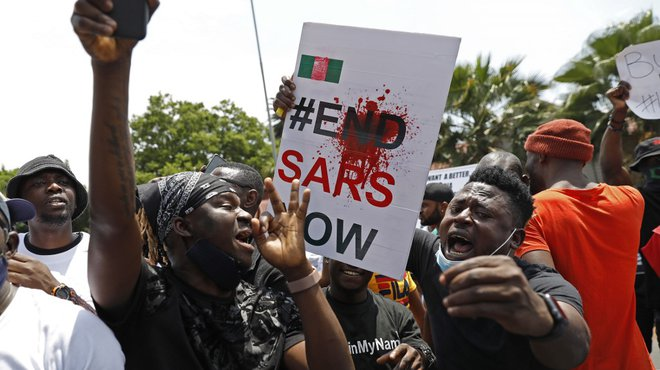 Nigerians based in South Africa protest outside their embassy in Pretoria on October 21, 2020 in solidarity with Nigerian youth who are demanding an end to police brutality in the form of The Nigerian Police Force Unit, Special Anti-Robbery Squad (SARS).