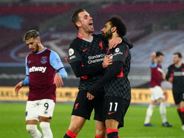 Liverpool Jordan Henderson Mohamed Salah - AFP