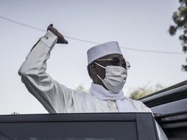 In this file photo taken on April 11, 2021 Chadian President Idriss Deby Itno greets supporters as he leaves after casting his ballot at a polling station in N'djamena. Chadian President Idriss Déby Itno, who has been in power for 30 years, died on April