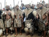 Newly elected Zulu monarch Prince Misuzulu Zulu (2nd R) arrives with Amabutho, Zulu regiments, to attend the provincial memorial service at the Khangelakamankegane Royal Palace in Nongoma on May 7, 2021 to pay his last respects to his mother the late Quee