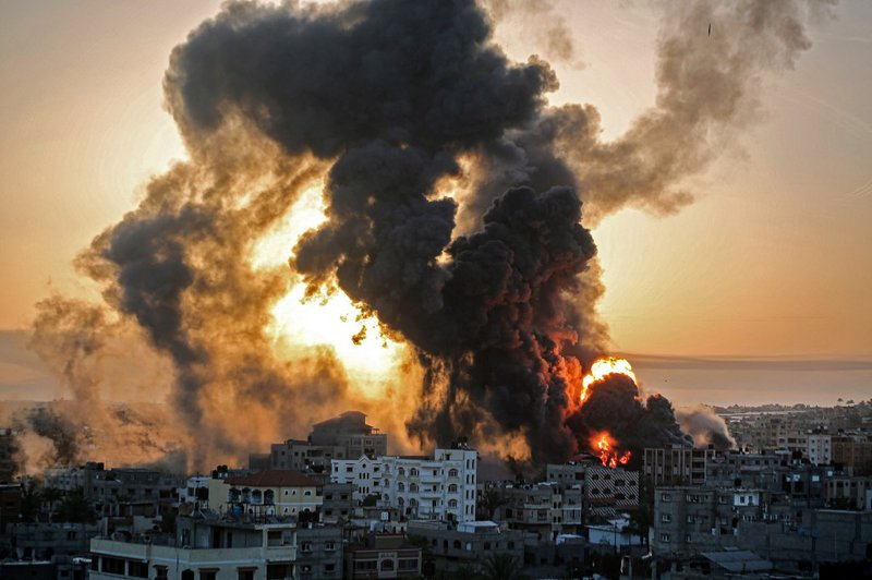A fire rages at sunrise in Khan Yunish following an Israeli airstrike on targets in the southern Gaza strip, early on May 12, 2021. Israeli air raids in the Gaza Strip have hit the homes of high-ranking members of the Hamas militant group, the military sa