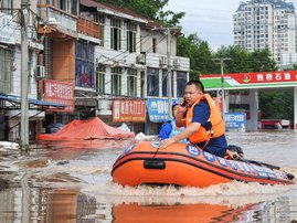 This photo taken on July 11, 2021 shows rescuers searching for residents affected by flood following heavy rains in Dazhou, in China's southwestern Sichuan province.