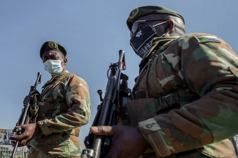 South Africa Defence Force (SANDF) soldiers stand guard in front of Maponya Mall in Soweto, on July 14, 2021. Unrest raged in South Africa on July 14, 2021, for the sixth day running, stoking fears of food and fuel shortages as disruption to farming, manu
