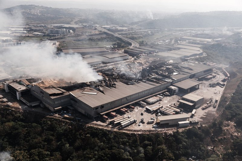 This aerial view taken on July 15, 2021, shows fire gutted at the Game store in Queen Nandi Drive in Durban. The businesses were hit by looters on July 13, despite the troops President Cyril Ramaphosa deployed to try to quell unrest. As pillaging erupted