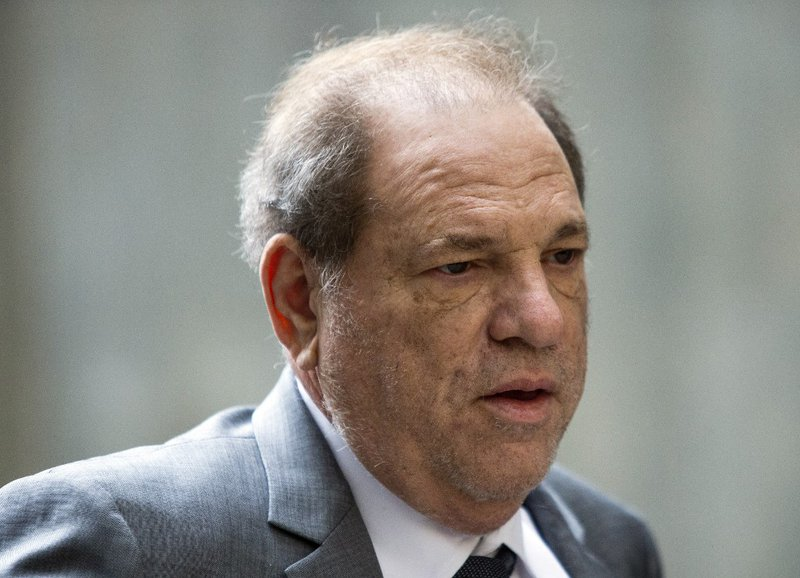 In this file photo movie mogul Harvey Weinstein arrives at Manhattan Supreme Court for a new bail hearing, on December 6, 2019, in New York. Disgraced movie producer Harvey Weinstein, who has been serving a 23-year prison sentence for sexual assault in Ne