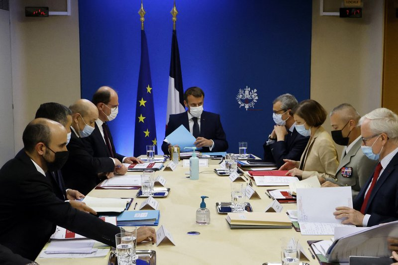French President Emmanuel Macron (C) flanked by French Prime Minister Jean Castex (4L), French European and Foreign Affairs Minister Jean-Yves Le Drian (3L), French Interior Minister Gerald Darmanin (2L), Secretary General of the Elysee Palace Alexis Kohl