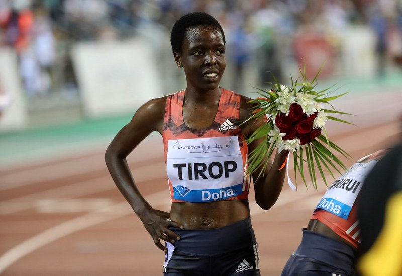 In this file photo taken on May 04, 2018 Agnes Jebet Tirop of Kenya celebrates after winning second-place in the women's 3000 metres race during the Diamond League athletics competition at the Suhaim bin Hamad Stadium in Doha. Record-breaking Kenyan dista