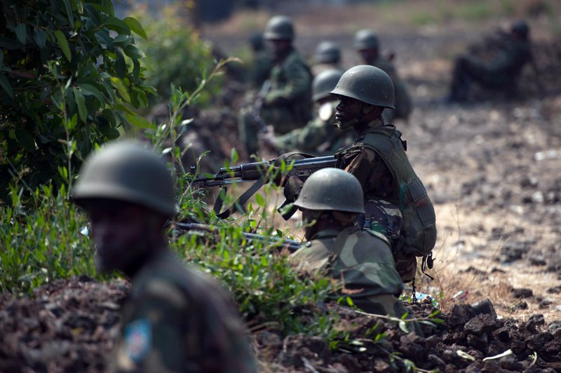 Congolese Army soldiers man a foward position in Kanyarucinya, some 12 kms from Goma, in the east of the Democratic Republic of the Congo on July 16, 2013. The army in the Democratic Republic of Congo on July 16 pursued an offensive against rebels of the