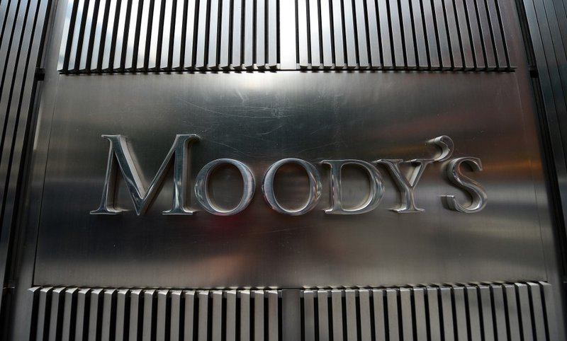 A sign for Moody's rating agency is displayed at the company headquarters in New York, September 18, 2012.