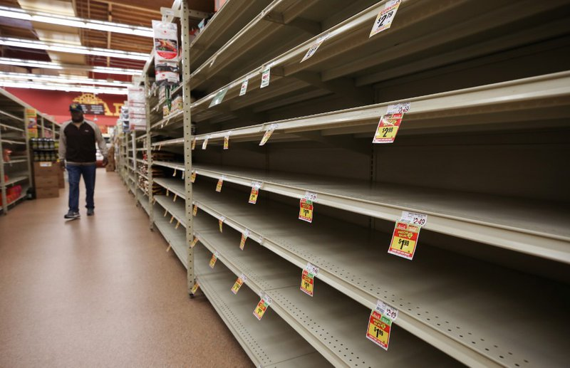 A section of empty shelves is seen during special shopping hours only open to seniors and the disabled at Northgate Gonzalez Market, a Hispanic specialty supermarket, on March 19, 2020 in Los Angeles, California. The vast majority of shelves in the market