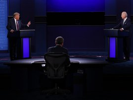 U.S. President Donald Trump and Democratic presidential nominee Joe Biden participate in the first presidential debate moderated by Fox News anchor Chris Wallace (C) at the Health Education Campus of Case Western Reserve University on September 29, 2020 i