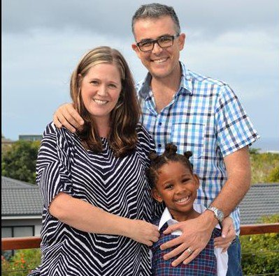 Justin Foxton and his wife and daughter