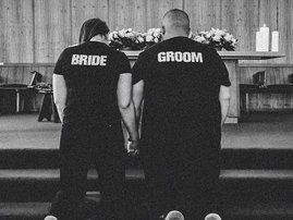 Jason Goliath and wife at the alter