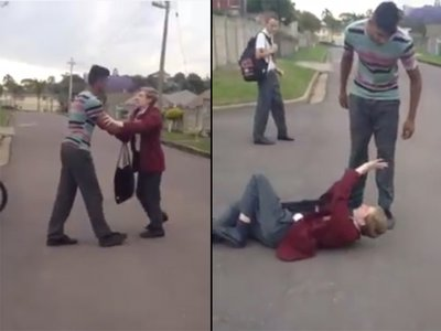 Video shows students beat up teacher after he grabs boy by