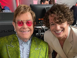 Charlie Puth standing with Elton John