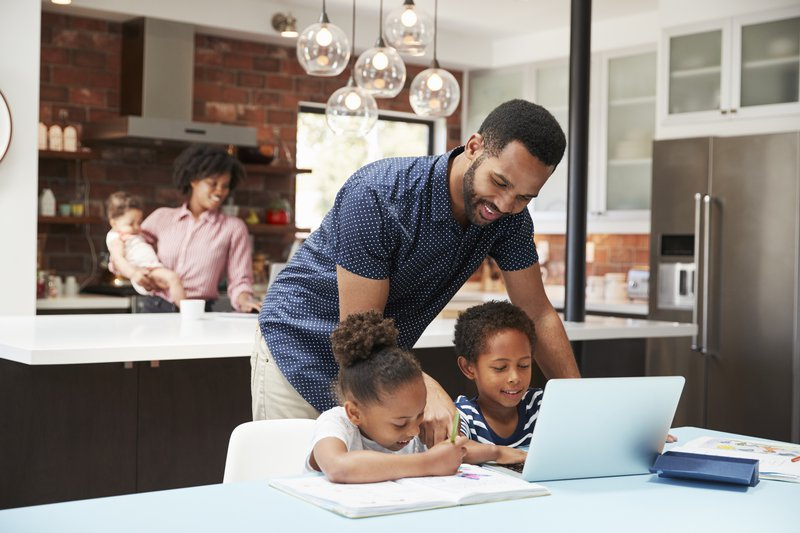 Father helping children with school work