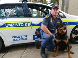 Constable_Brandon_Gates_patrol_dog_Zues.jpg