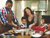 Family making food together