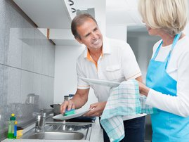 Couple washing dishes