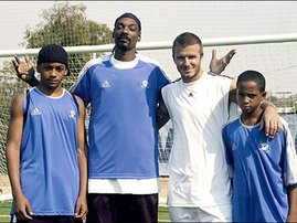 Snoop Dogg and sons with David Beckham on soccer pitch