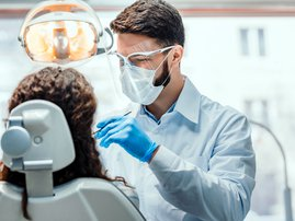 Dentist checking a woman patient