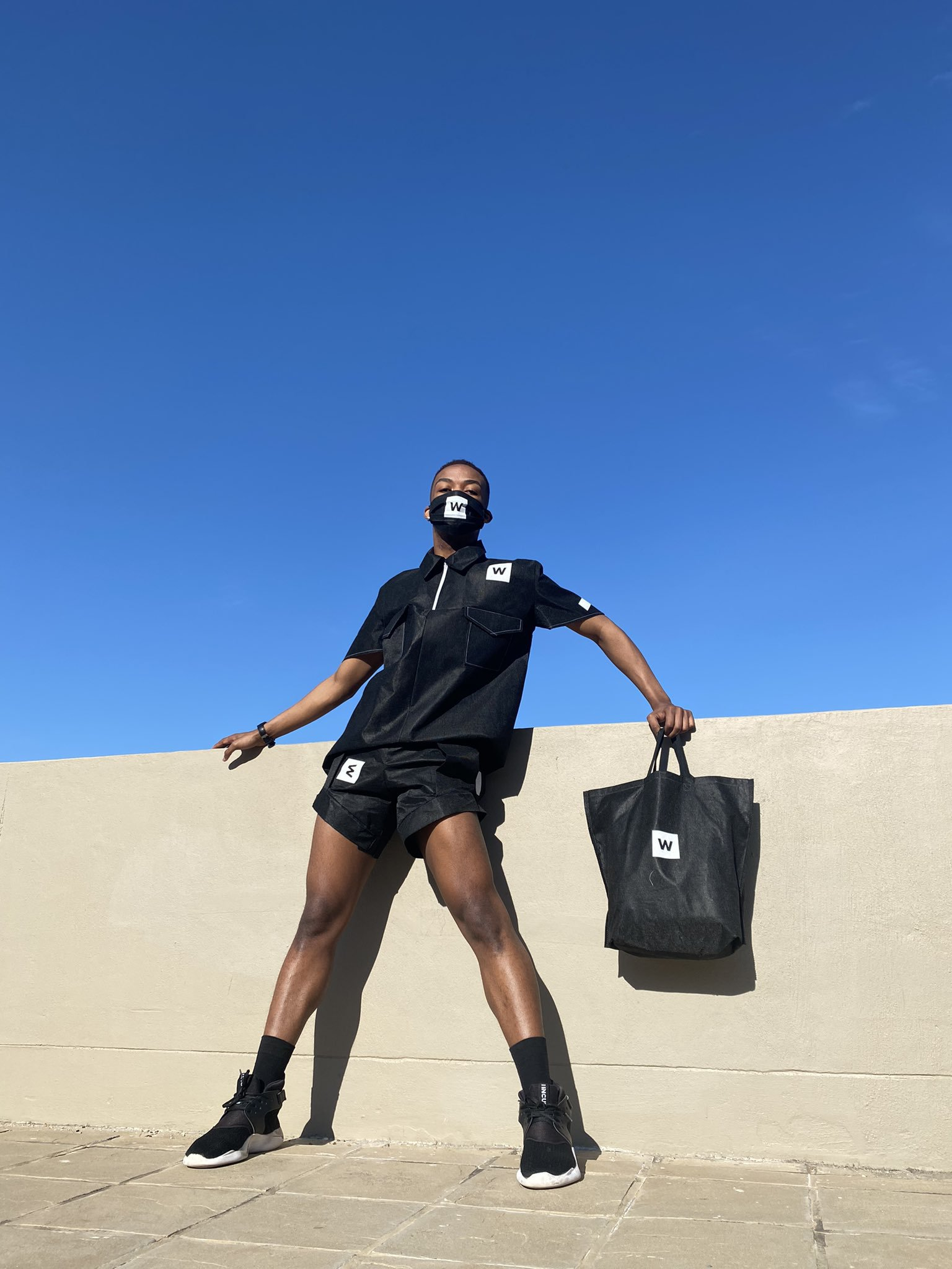 Bhungane Mehlomakhulu creates outfit using Woolworths bags