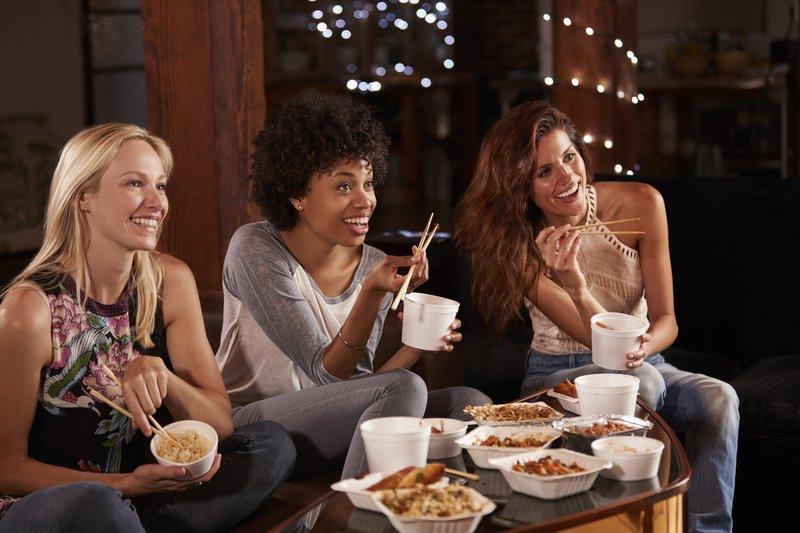 Women eating while watching TV